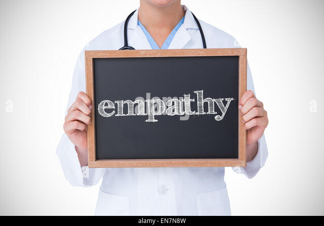 Empathy against doctor showing little blackboard - Stock Image