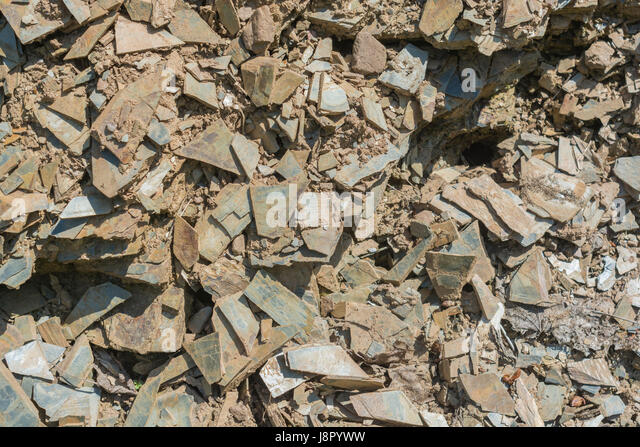 Close up of some splintered / shaptered slate-type stone. Concept 'fall on stony ground', warnings or advice - Stock Image