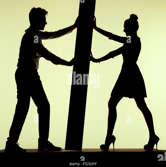 Young joyful couple and the pushing play - Stock Image