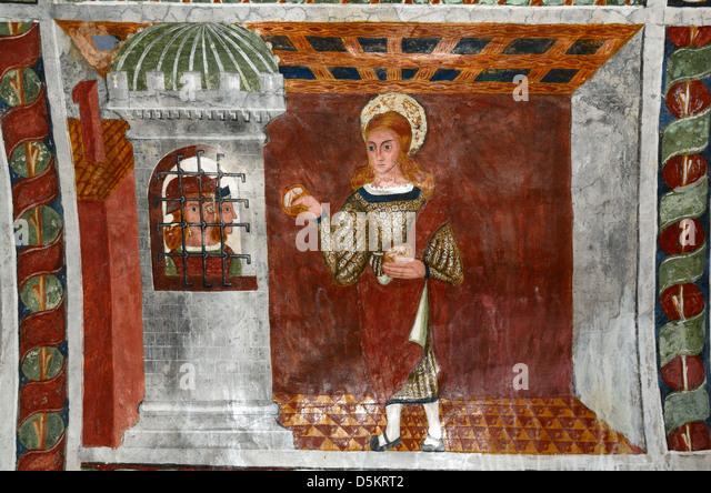 Fresco Saint Sebastian Bringing Bread to Imprisoned Christians (1513) Chapel of Saint Sebastian Roubion Alpes-Maritimes - Stock Image