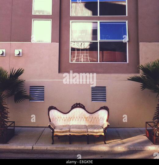 Vintage couch on sidewalk - Stock-Bilder