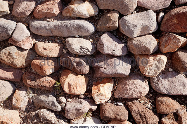 Dry Rock Wall rounded stones texture background - Stock-Bilder