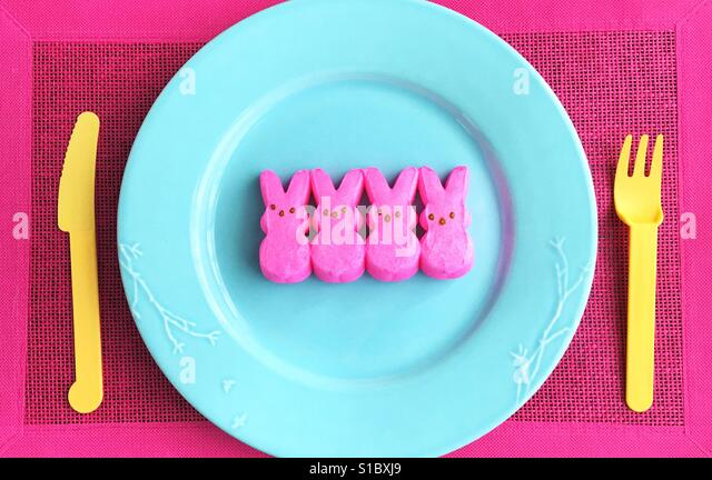 Peeps bunnies on a plate. - Stock Image