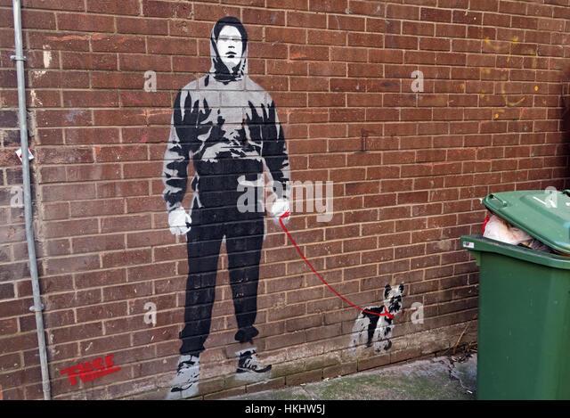 Boy walking dog stencil,Glasgow Queen St, Scotland - Stock Image