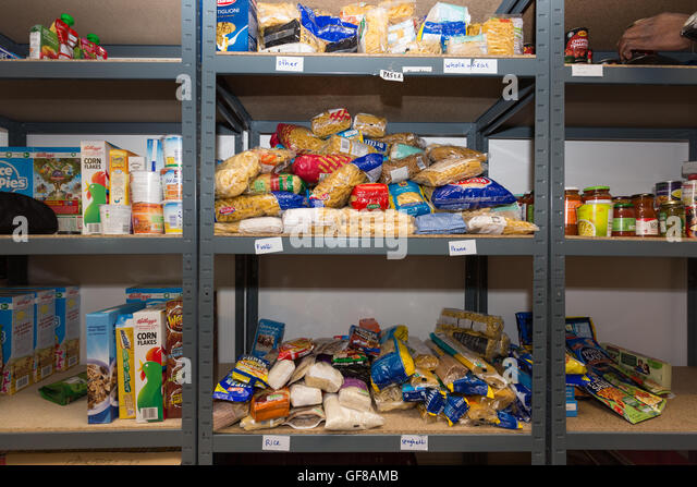 The shelves of a food bank containing dry provisions - Stock Image