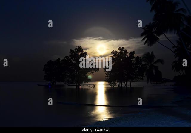 Bright yellow super moon in Biduk-Biduk village - Stock Image