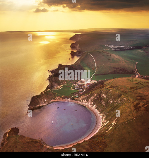 Aerial image of Lulworth Cove, a natural landform harbour, near West Lulworth, on the Jurassic Coast, UNESCO, Dorset, - Stock Image