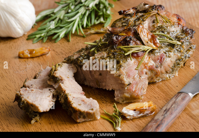 Pork shoulder with herbs - Stock Image