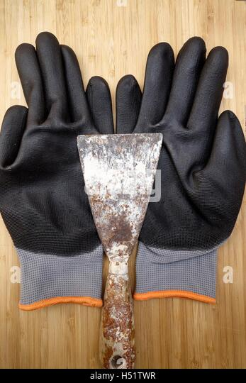 Protective DIY Gloves and Filling Knife - Stock Image