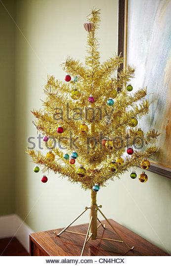 Gold christmas tree - Stock Image