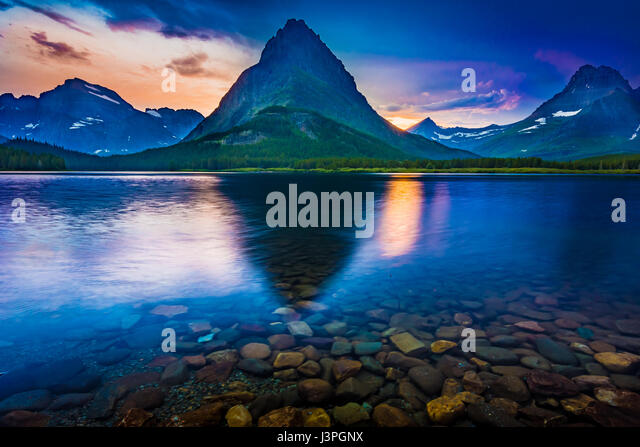 Swiftcurrent Lake is located in the Many Glacier region of Glacier National Park, in the U.S. state of Montana. - Stock Image
