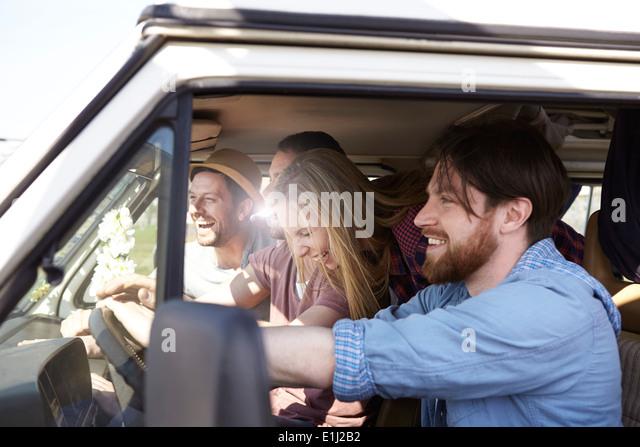 Happy friends in minivan - Stock Image