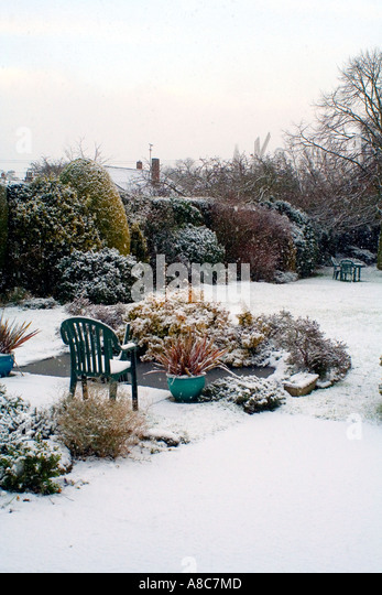 Snowing and an English Garden in the winter - Stock Image