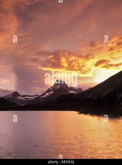 Sunset on Swiftcurrent Lake with Mount Wilbur Glacier National Park Montana - Stock-Bilder