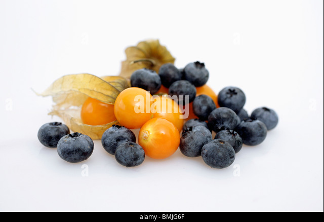 Closeup on fruits and berries - Stock Image