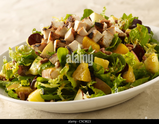Grilled chicken, potato and orange salad - Stock Image