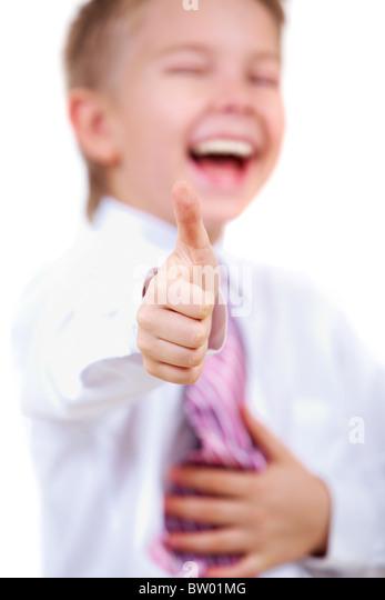 Image of happy boy showing thumb up - Stock Image