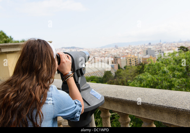 Young female tourist looking at view of Barcelona, Spain - Stock-Bilder