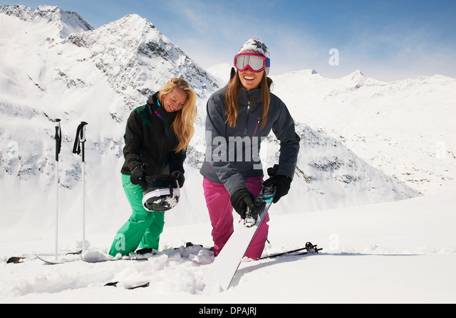 Two woman in snow with skis, Obergurgl, Austria - Stock Image