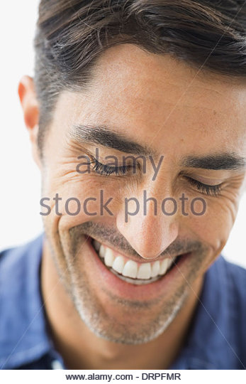 Close-up portrait of smiling man - Stock Image