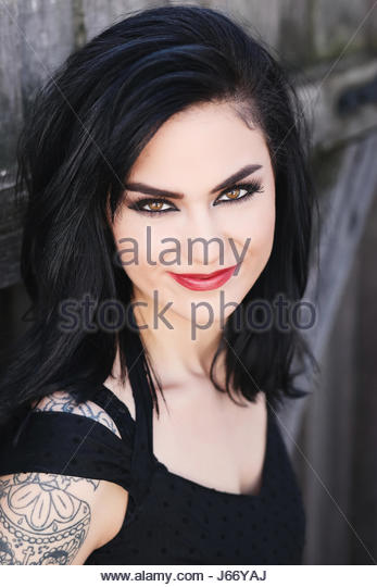 Portrait of a dark haired young woman - Stock Image
