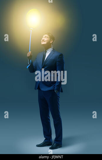 Businessman with bright balloon in business concept - Stock Image