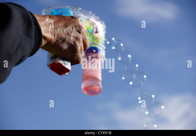 Gun maker stock photos gun maker stock images alamy for How to make a bubble blower from a water bottle