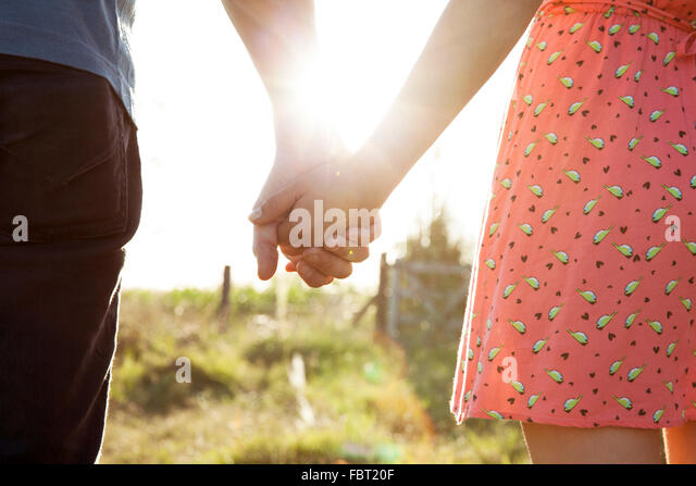 Couple holding hands, close-up - Stock-Bilder