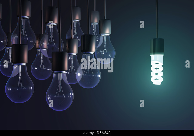 energy-saving lamp among the gray bulb - Stock-Bilder