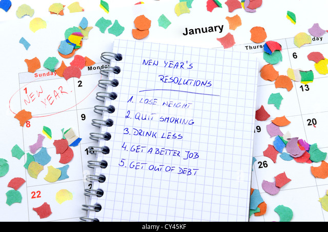New Year's resolutions listed in circle notepad - Stock Image