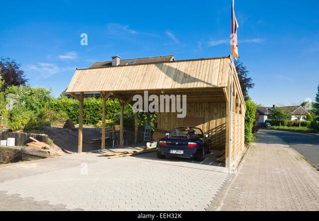 Solar Carport 'Sunport' providing shelter and charging energy for two EV electric cars - here with a conventional - Stock Image