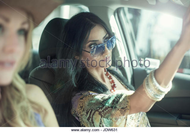 Two female friends on car journey together - Stock-Bilder