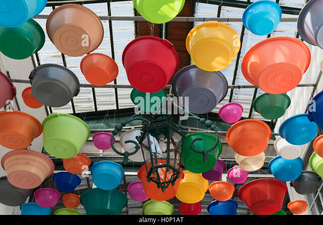 Colourful bowls as decoration Feira da Ladra Thieves' Market Campo de Santa Clara Lisbon Portugal - Stock Image