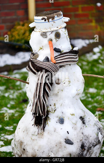 Depressed Snowman During A Thaw - Stock Image