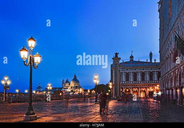 San Marco square along grand canal Gondola pier with Venice republic symbols on erected columns towards Santa Maria - Stock Image