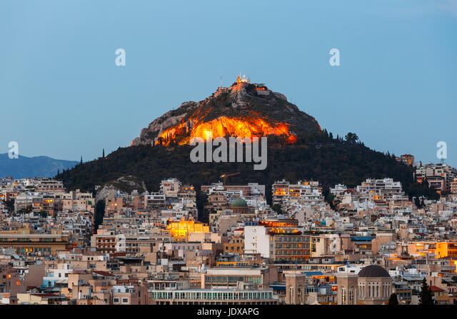 View of Lycabettus hill and one of the Athenian neighbourhoods, Greece. - Stock Image