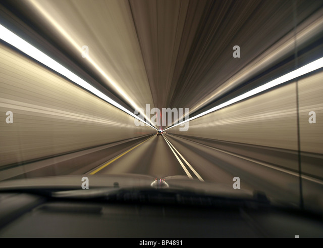 Speeding through a deep urban tunnel in Pittsburgh Pennsylvania. - Stock Image