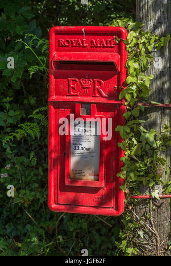 Royal Mail red post box on a country lane (near village of St. Dennis, Cornwall). - Stock Image