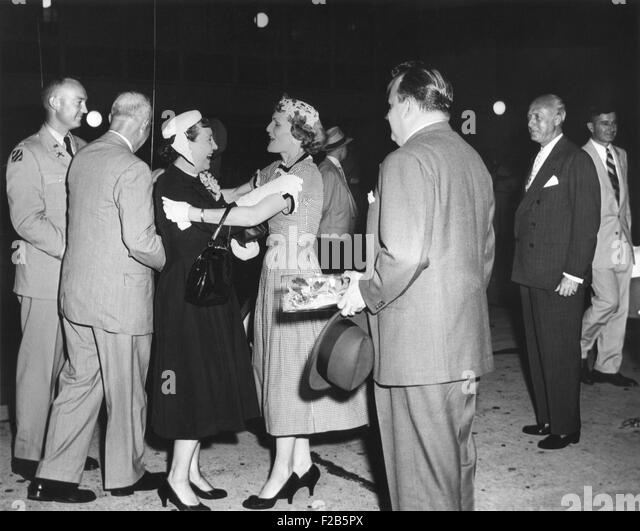 Pat Nixon embraces Mamie Eisenhower at National Airport. July 15, 1955. The First Lady, the President and his aide, - Stock Image