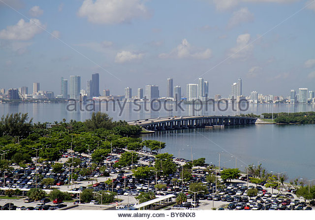 Miami Beach Florida Biscayne Bay parking lot cars Julia Tuttle Causeway skyline high rise condominium buildings - Stock Image