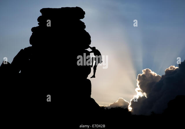 Man free climbing on a rock face at Hound Tor on Dartmoor in Devon - Stock-Bilder
