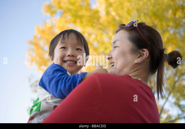 A mother holding her son, portrait - Stock-Bilder