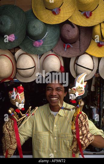 Indonesia Southeast Asia Jakarta gotang dolls hats souvenir vendor culture - Stock Image