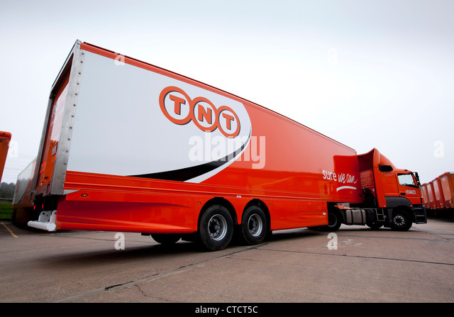 TNT trucks and trailers pictured in the depot at Atherstone,,UK. The trailers are the aerodynamic cheetah version. - Stock Image