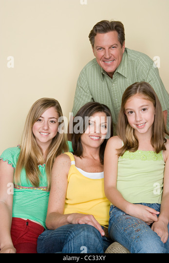 Portrait of happy three-generation family with two girls (8-9, 14-15) - Stock-Bilder