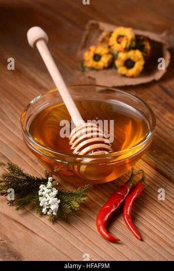 honey chilli pepper in glass bowl - Stock Image
