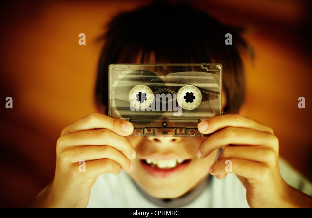 Boy holds old casette tape. - Stock-Bilder