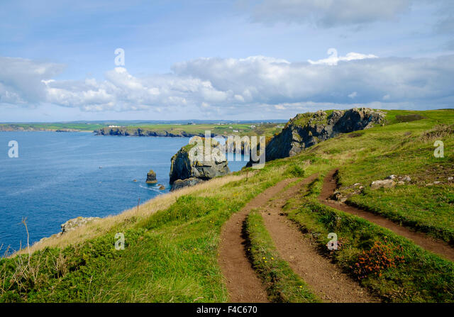 South West Coast path and coastline near Mullion, Lizard Peninsula, Cornwall, England, UK - Stock Image