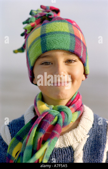 Portrait of cheeky young Indian boy - Stock Image