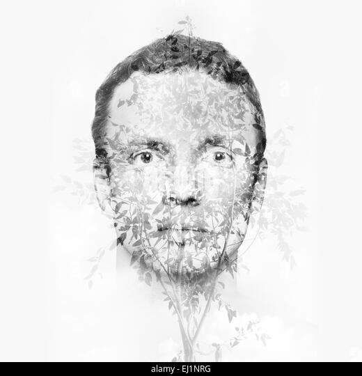 Double exposure monochrome abstract conceptual collage, man face and small tree leaves pattern - Stock-Bilder